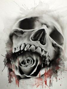 Tattoo teschio realistico con rosa in bocca