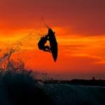 Sfondo surfista al tramonto